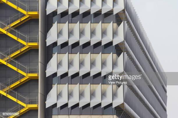 Aluminium sun shading system and stairways of exterior facade. Siemens Masdar, Abu Dhabi, United Arab Emirates. Architect: Sheppard Robson, 2014.