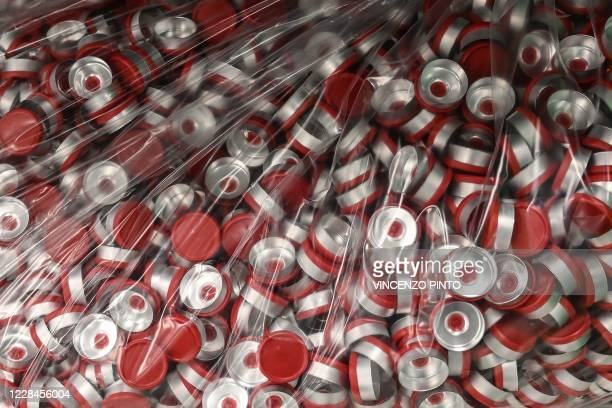 Aluminium vial caps are being pictured within filling and packaging tests for the large-scale production and supply of the University of Oxfords...
