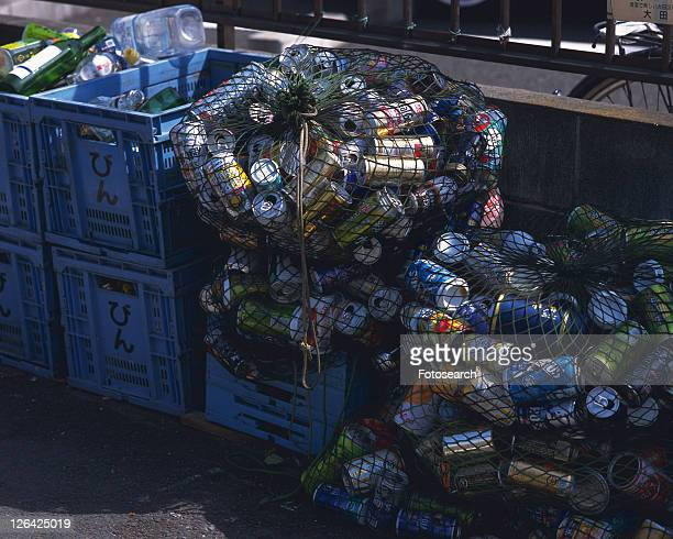 Aluminum cans for recycling in plastic boxes, high angle view