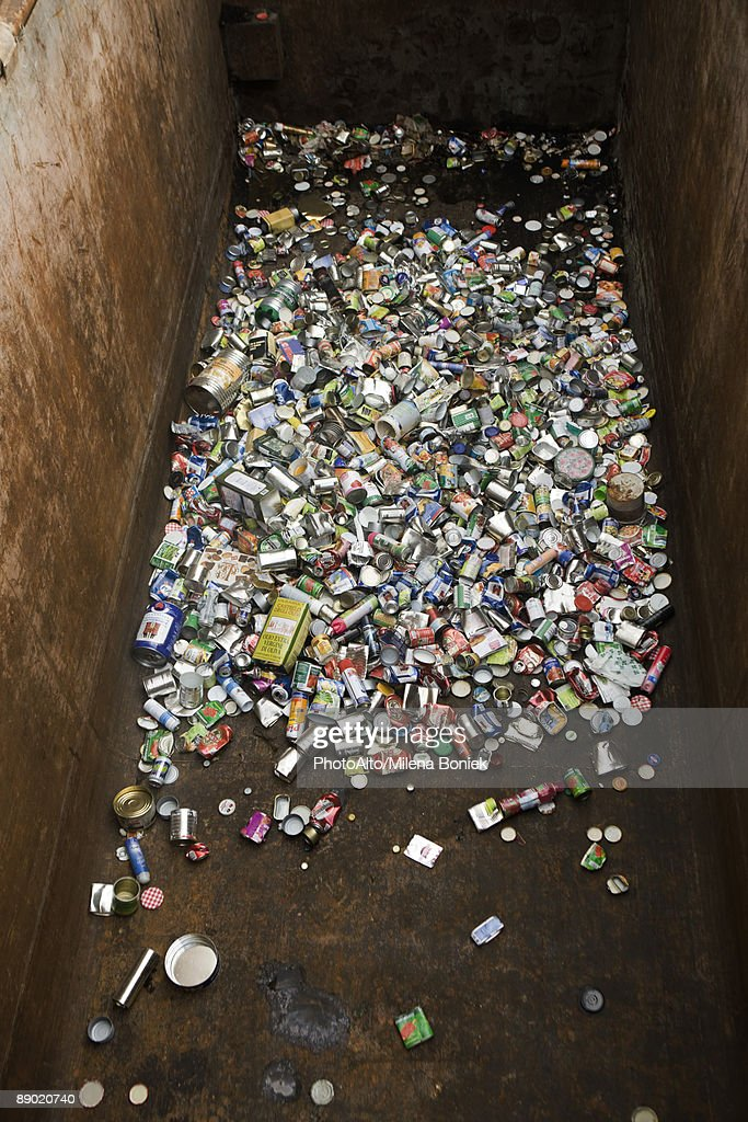 Aluminum cans in large recycling bin : Stock Photo