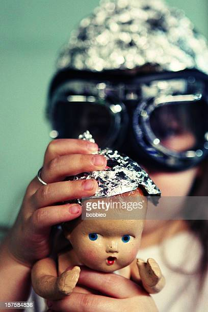 Aluminum foil head doll