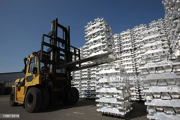 Aluminum ingots are moved with a forklift at the Public Procurement Service Incheon base warehouse in Incheon South Korea on Thursday Sept 22 2011...