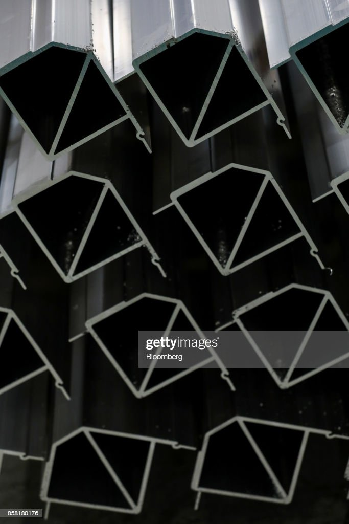 Aluminum parts are stacked at the Sapa SA aluminum plant in Bedwas, U.K., on Wednesday, Oct. 4, 2017. After being closed for three years due to a weak market, Sapa's aluminum plant in south Wales reopened to supply lightweight parts for automakers such as London Electric Vehicle Co., the maker of black cabs. Photographer: Luke MacGregor/Bloomberg via Getty Images
