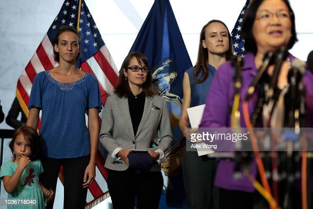 Alumnae Kate Gold Alexis Goldstein and Sarah Burgess wait to deliver a letter signed by HoltonArms alumnae in support of Christine Blasey Ford who...
