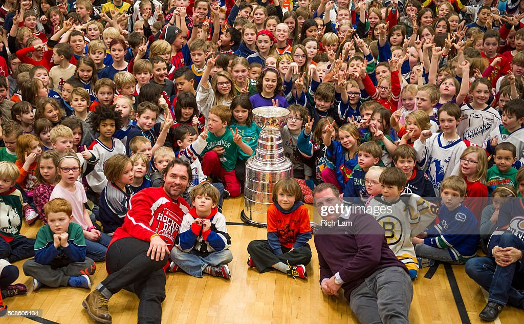 NHL Alumni Darcy Tucker and Mark Recchi pose for a photo with the Stanley Cup and students of Lloyd George Elementary School for on Day 2 of 2016 Scotiabank Hockey Day in Canada on February 5, 2016 in Kamloops, British Columbia, Canada.