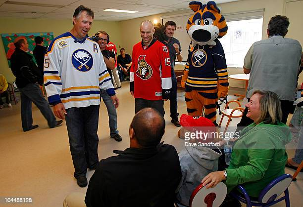 Alumni Dave Andreychuk and Shawn McEachern meet with patients and their families at McMaster Children's Hospital during NHL Kraft Hockeyville 2010 on...