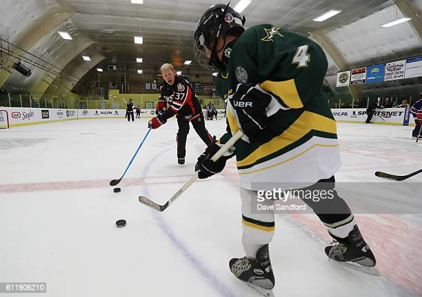 Alumni Dean McAmmond instructs in the on ice clinic at the Pat Duke Memorial Arena during Day 2 of NHL Kraft Hockeyville Canada on October 1 2016 in...