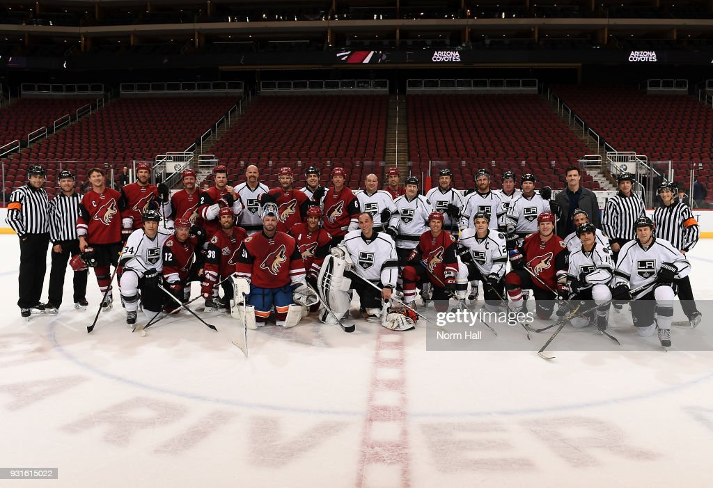 Alumni from both the Arizona Coyotes and the Los Angeles Kings pose for a team photo after playing an exhibition game prior to the Kings at Coyotes game at Gila River Arena on March 13, 2018 in Glendale, Arizona.