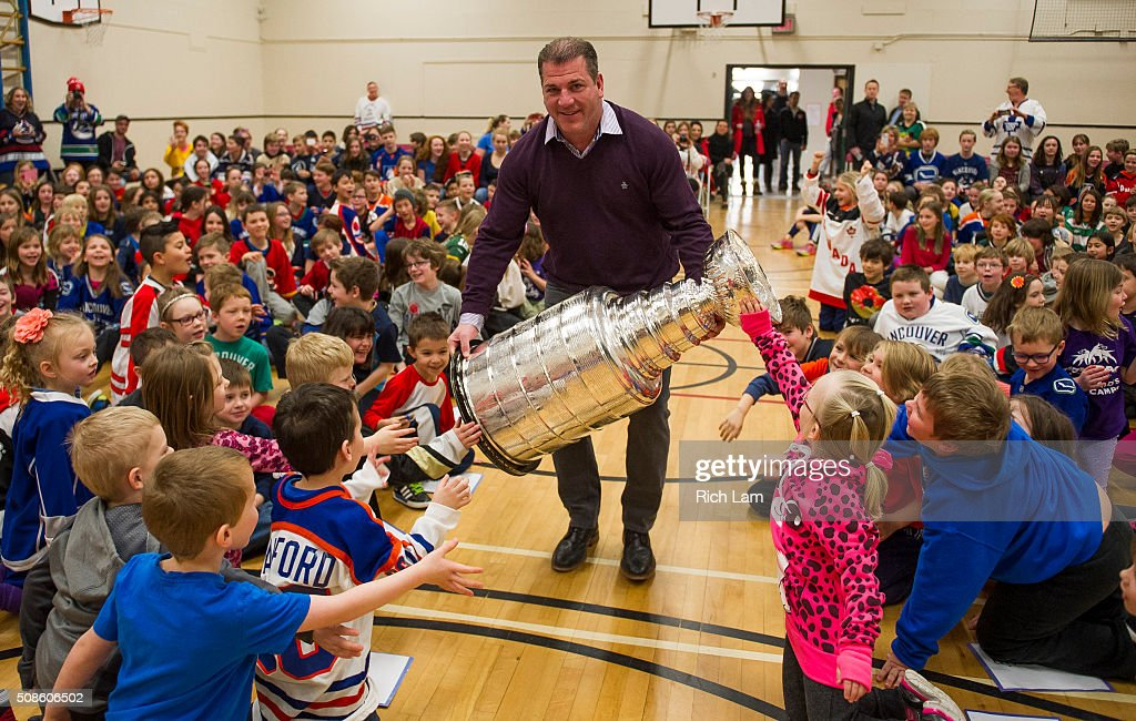 NHL Alumni Mark Recchi carries the Stanley Cup into Lloyd George Elementary School while on a visit on Day 2 of 2016 Scotiabank Hockey Day in Canada on February 5, 2016 in Kamloops, British Columbia, Canada.