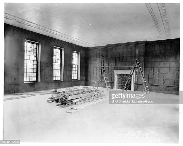 Alumni Memorial Residences Interior of AMR Room unidentified Room with crown molding and wood paneling appears to be finished Several ladders lie...