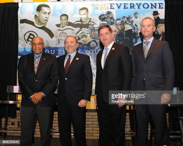 Alumni player Willi O'Ree of the Boston Bruins poses with the NHL Commissioner Gary Bettman Boston Mayor Marty Walsh and Chief Executive Charlie...