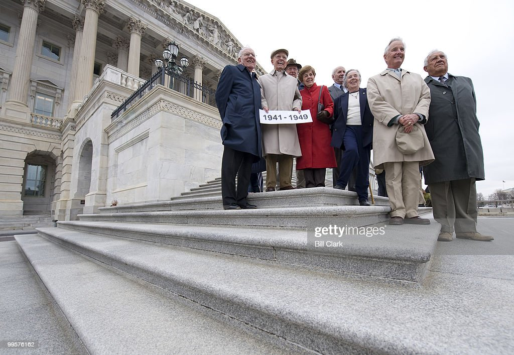 Alumnus of the Congressional Page School form the 1940's gather on the House steps of the U.S. Capitol for a group photo during the 2008 reunion on Friday, April 4, 2008.