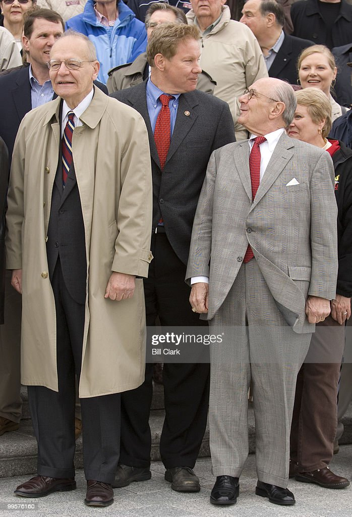 Alumnus of the Congressional Page School, including from left, Ken Jorski, Rep. Tom Davis, R-Va., and Lowell Baier, gather on the House steps of the U.S. Capitol for a group photo during the 2008 reunion on Friday, April 4, 2008.