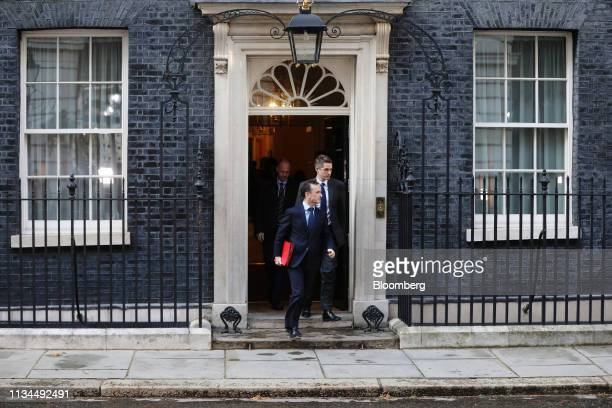 Alun Cairns UK Welsh secretary left and Gavin Williamson UK defence secretary depart from a meeting of cabinet ministers inside number 10 Downing...