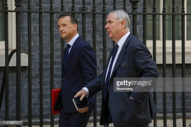 Alun Cairns UK Welsh secretary left and Geoffrey Cox UK attorney general right arrive for a meeting of cabinet minsters at number 10 Downing Street...