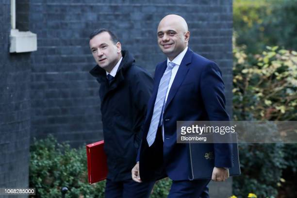 Alun Cairns UK Welsh secretary left and Sajid Javid UK home secretary right arrive for a weekly meeting of cabinet minister at number 10 Downing...