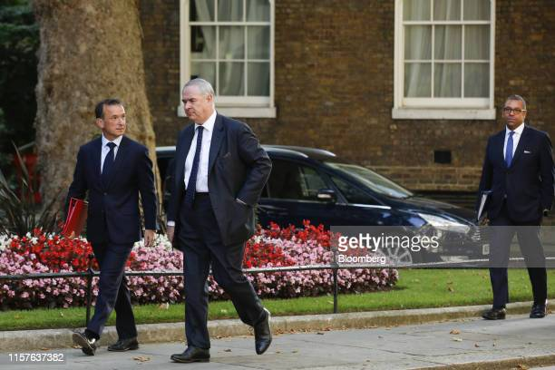 Alun Cairns UK Welsh secretary left Geoffrey Cox UK attorney general center and James Cleverly chairman of the Conservative Party arrive for a...