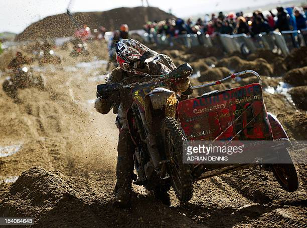 Alun Davies rides his sidecar along a straight during the main quad and sidecar race during the 2012 RHL Weston beach race in WestonSuperMare...