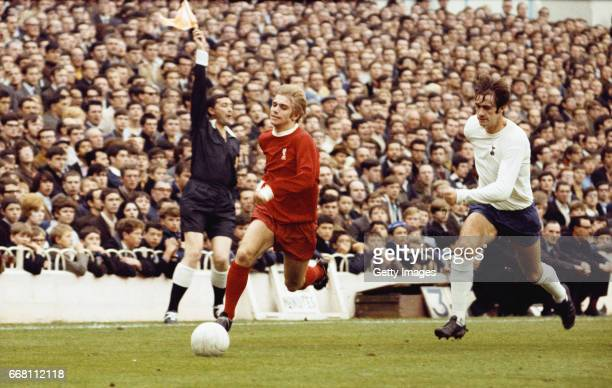 Alun Evans of Liverpool outpaces Cyril Knowles of Spurs as the linesman flags during a First Division match against Tottenham Hotspur at White Hart...