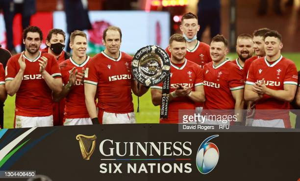 Alun Wyn Jones and Dan Biggar of Wales lift the Triple Crown trophy following their side's victory in the Guinness Six Nations match between Wales...