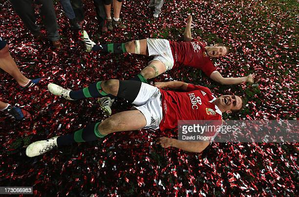 Alun Wyn Jones and Jamie Roberts of the Lions roll around in the confetti after their victory during the International Test match between the...