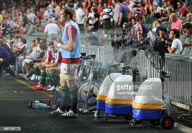 Alun Wyn Jones of the Lions cools off using portable fans during the match between the British Irish Lions and the Barbarians at Hong Kong Stadium on...