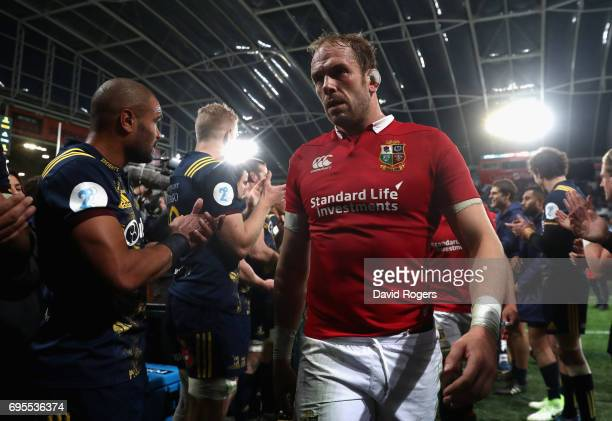 Alun Wyn Jones of the Lions leads the team off the pitch after their defeat during the 2017 British Irish Lions tour match between the Highlanders...
