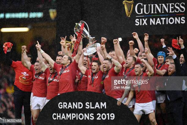 Alun Wyn Jones of Wales and Jonathan Davies of Wales lift the Six Nations and Triple Crown Trophy to celebrate winning the Six Nations with there...