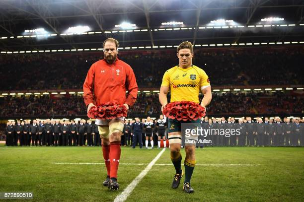 Alun Wyn Jones of Wales and Michael Hooper of Australia both place a poppy reef on the pitch prior to the Under Armour Series match between Wales and...