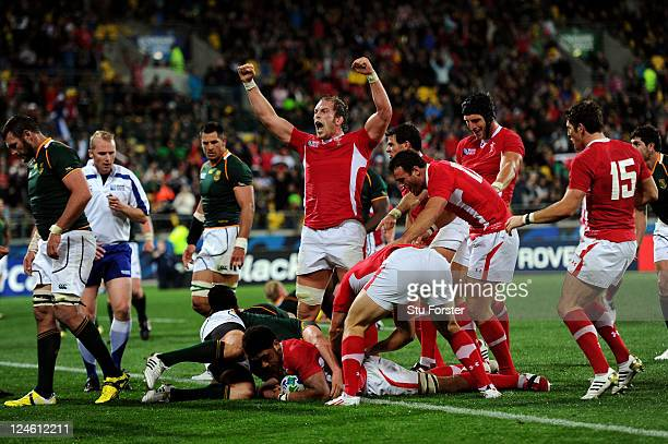 Alun Wyn Jones of Wales celebrates after teammate Toby Faletau scores his team's first try during the IRB 2011 Rugby World Cup Pool D match between...