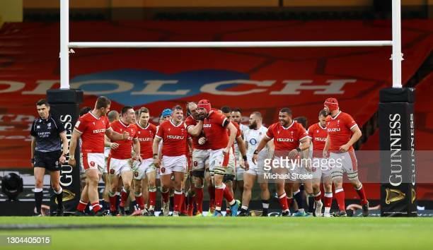 Alun Wyn Jones of Wales congratulates Cory Hill of Wales after scoring their side's fourth try during the Guinness Six Nations match between Wales...