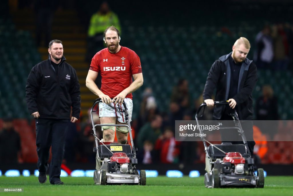 Alun Wyn Jones of Wales helps the groundmen after the game to mow the grass during the international match match between Wales and South Africa at Principality Stadium on December 2, 2017 in Cardiff, Wales.