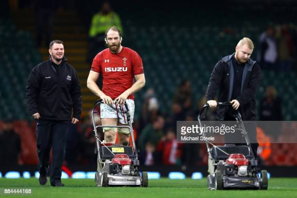 Alun Wyn Jones of Wales helps the groundmen after the game to mow the grass during the international match match between Wales and South Africa at...