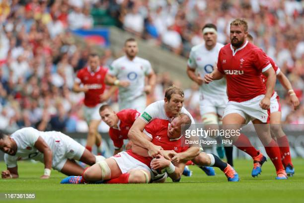 Alun Wyn Jones of Wales is tackled by Joe Launchbury of England during the 2019 Quilter International match between England and Wales at Twickenham...