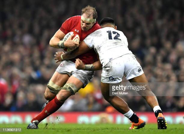 Alun Wyn Jones of Wales is tackled by Manu Tuilagi of England during the Guinness Six Nations match between Wales and England at Principality Stadium...