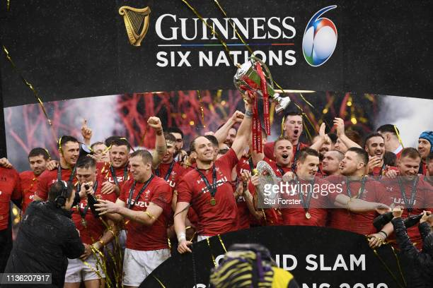 Alun Wyn Jones of Wales lifts the Six Nations trophy as he celebrates winning the Six Nations and the Tripple Crown after the Guinness Six Nations...