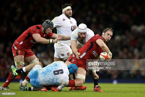 Alun Wyn Jones of Wales looks to offload as is tackled by James Haskell of England and Dave Attwood of England during the RBS Six Nations match...