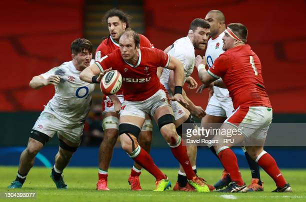 Alun Wyn Jones of Wales looks to pass the ball as Tom Curry of England looks to challenge during the Guinness Six Nations match between Wales and...