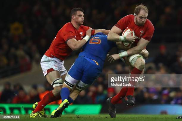 Alun Wyn Jones of Wales powers past the challenge of Wenceslas Lauret of France during the NatWest Six Nations match between Wales and France at the...