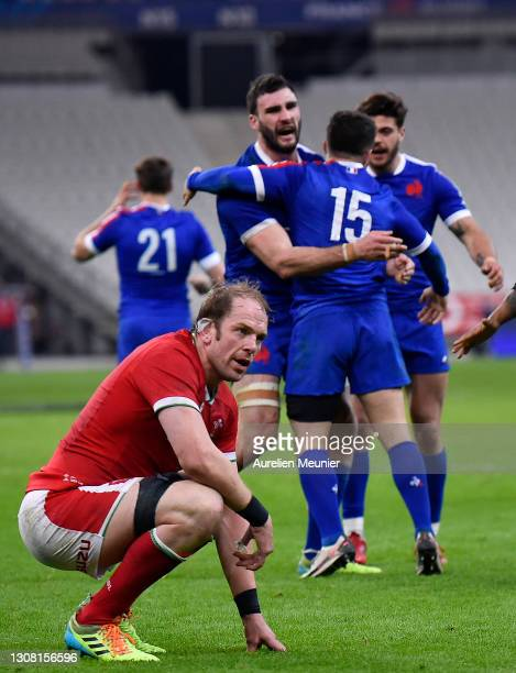 Alun Wyn Jones of Wales reacts as Brice Dulin of France celebrates his winning try with Charles Ollivon during the Guinness Six Nations match between...