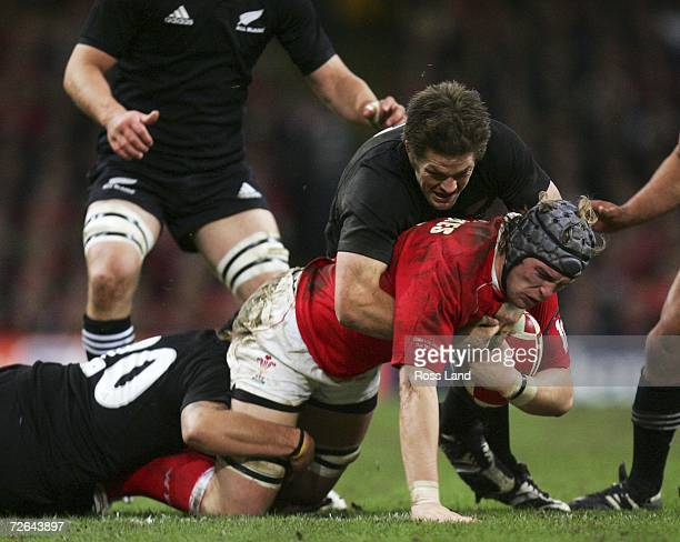 Alun Wyn Jones of Wales tackled by Prir Weepu and Richie McCaw of the All Blacks during the international rugby match between Wales and New Zealand...
