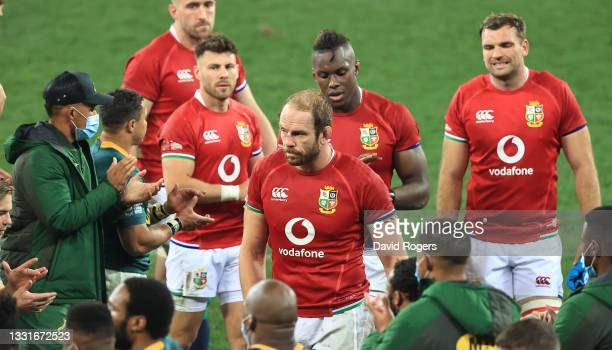 Alun Wyn Jones, the Lions captain, looks dejected as he leads his team off the pitch after their defeat during the 2nd test match between South...