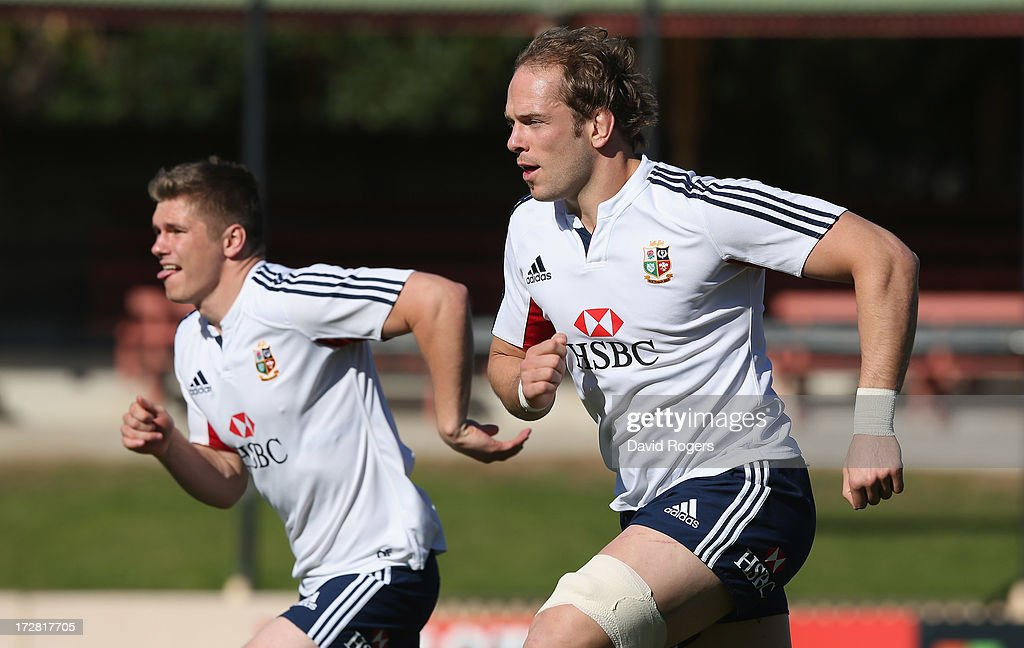 Alun Wyn Jones (R), the Lions captain, runs with team mate Owen Farrell during the British and Irish Lions Captain's Run at North Sydney Oval on July 5, 2013 in Sydney, Australia.