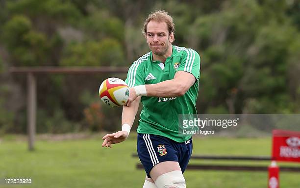 Alun Wyn Jones who will captain the Lions in the third and final test against the Wallabies passes the ball during a British Irish Lions training...