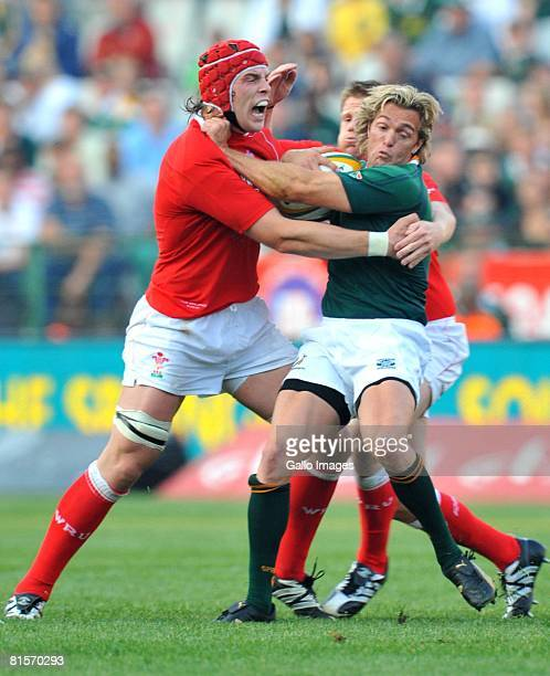 AlunWyn Jones of Wales tackles Percy Montgomery of South Africa during the second International Test match between South Africa and Wales held at...