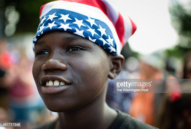 Alusine Brown of Silver Spring listens to the performance of a whistled version of America The Beautiful He was there with his twin brother and...