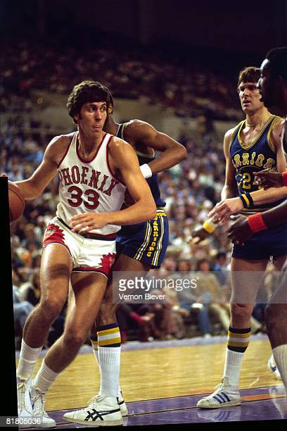 Alvan Adams of the Phoenix Suns drives to the basket against the Golden State Warriors during the 1977 season at Veterans Memorial Arena in Phoenix...