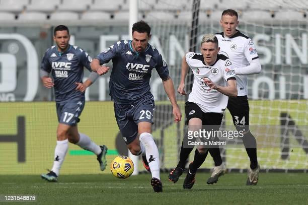 Alvares Estevez of Spezia Calcio battles for the ball with Artur Ionita of Benevento Calcio during the Serie A match between Spezia Calcio and...