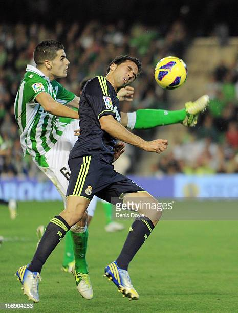 Alvaro Albeloa of Real Madrid competes with Alex Martinez of Real Betis Balompie during the La Liga match between Real Betis Balompie and Real Madrid...