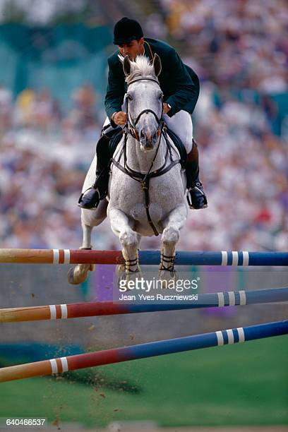 Alvaro Alfonso de Miranda Neto of Brazil negotiates a fence during a jumping event at the Olympic Games